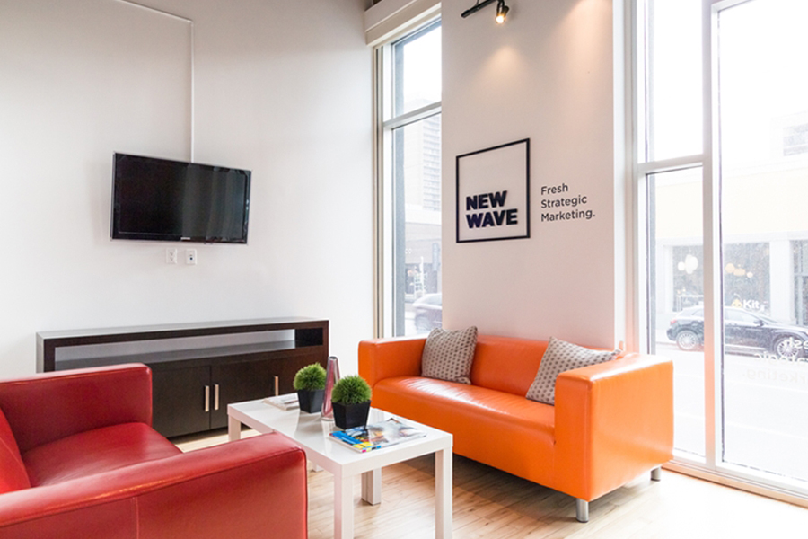 New Wave Marketing Agency Calgary Front office orange couch