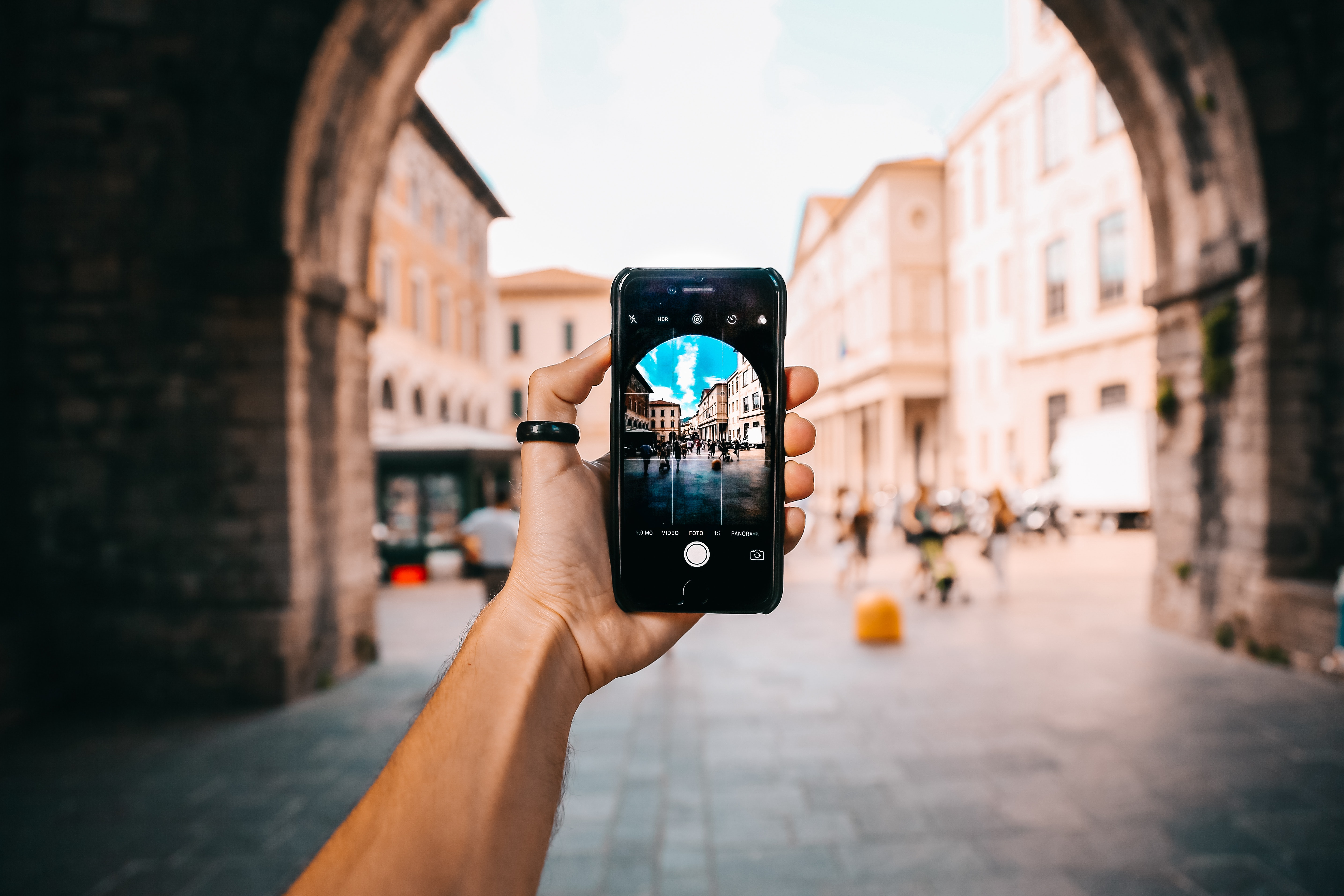 Taking a picture of Italy with a smartphone for social media marketing
