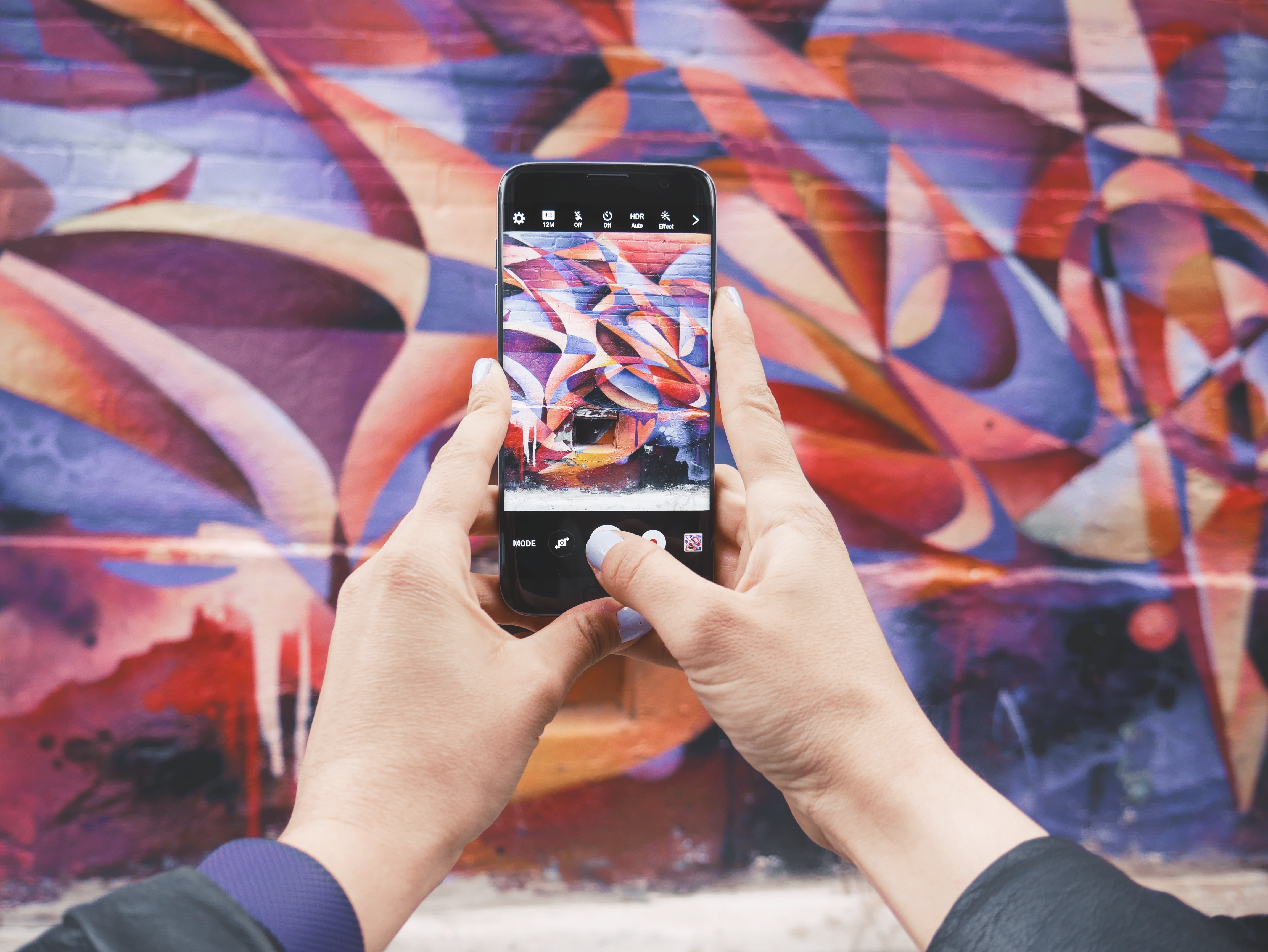 Taking a picture of graffiti with a smartphone for social media marketing